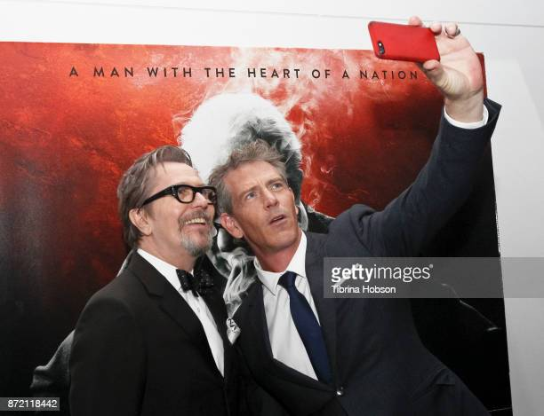 Gary Oldman and Ben Mendelsohn take a selfie at the premiere of Focus Features 'Darkest Hour' after party on November 8 2017 in Beverly Hills...