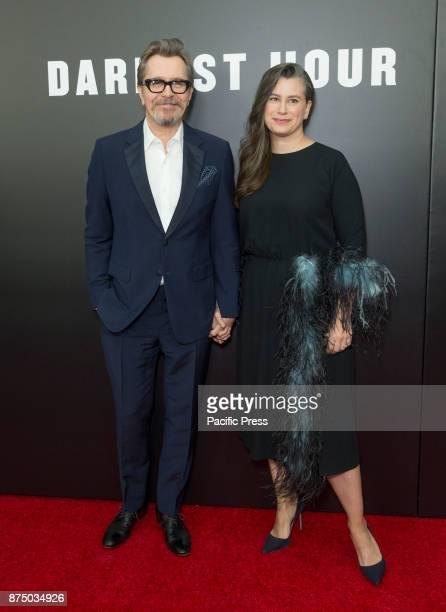 Gary Oldman and Gisele Schmidt attend Darkest Hour premiere at Paris movie theater