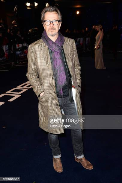 Gary Oldman attends the world premiere of 'RoboCop' at The IMAX on February 05 2014 in London England