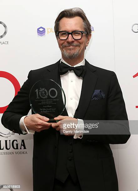 Gary Oldman winner of the Dilys Powell Award for Excellence in Film poses with his award during the London Critics' Circle Film Awards at The Mayfair...