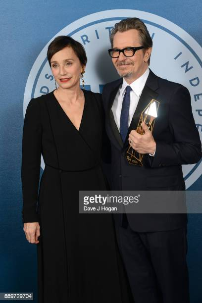 Gary Oldman winner of The Variety Award presented by Kristin Scott Thomas in the winners room at the British Independent Film Awards held at Old...