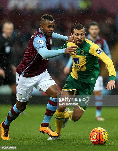 Gary O'Neil of Norwich City and Leandro Bacuna of Aston Villa compete for the ball during the Barclays Premier League match between Aston Villa and...