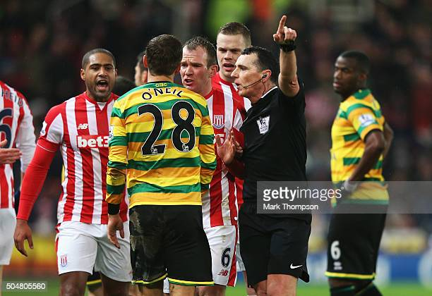 Gary O'Neil of Norwich City argues with Stoke City players after sending off by referee Neil Swarbrick during the Barclays Premier League match...