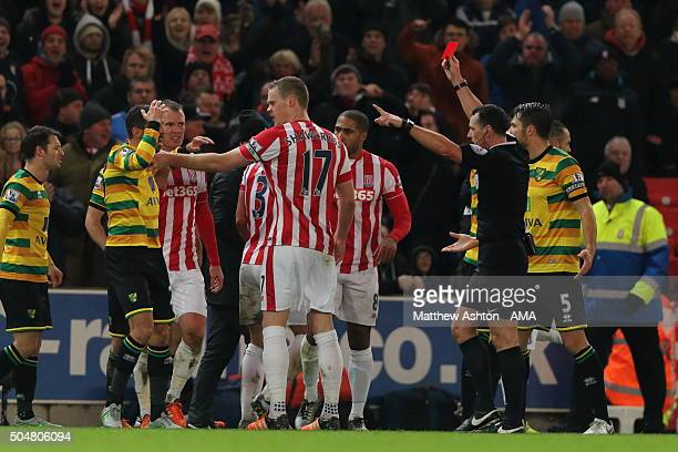 Gary O'Neil of Norwich City gets a red card during the Barclays Premier League match between Stoke City and Norwich City at the Britannia Stadium on...