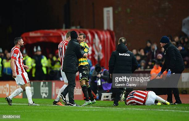 Gary O'Neil of Norwich City reacts after fouling Ibrahim Afellay of Stoke City during the Barclays Premier League match between Stoke City and...