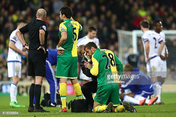 Gary O'Neil of Norwich City receives medical treatment after bleeding from forehead during the Barclays Premier League match between Norwich City and...