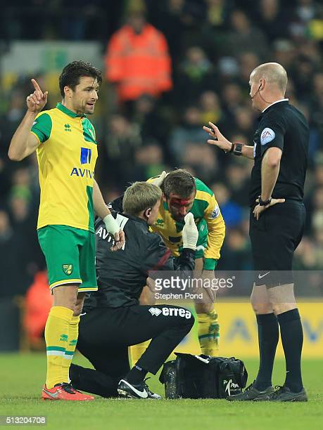 Gary O'Neil of Norwich City receives medical treatment after the collision during the Barclays Premier League match between Norwich City and Chelsea...