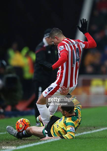 Gary O'Neil of Norwich City tackles Ibrahim Afellay of Stoke City resulting in the red card during the Barclays Premier League match between Stoke...