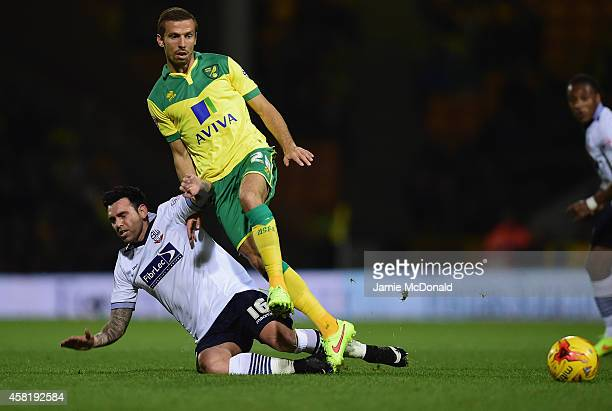 Gary O'Neil of Norwich City tackles Mark Davies of Bolton during the Sky Bet Championship match between Norwich City and Bolton Wanderers at Carrow...