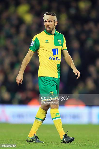 Gary O'Neil of Norwich City wearing bandage looks on during the Barclays Premier League match between Norwich City and Chelsea at Carrow Road on...