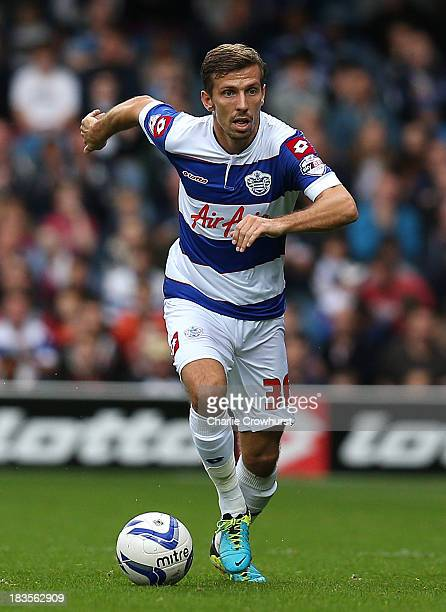 Gary O'Neil of QPR attacks during the Sky Bet Championship match between Queens Park Rangers and Barnsley at Loftus Road on October 05 2013 in London...