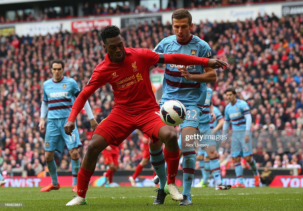 Gary O'Neil of West Ham United challenges Daniel Sturridge of Liverpool during the Barclays Premier League match between Liverpool and West Ham United at Anfield on April 7, 2013 in Liverpool, England.