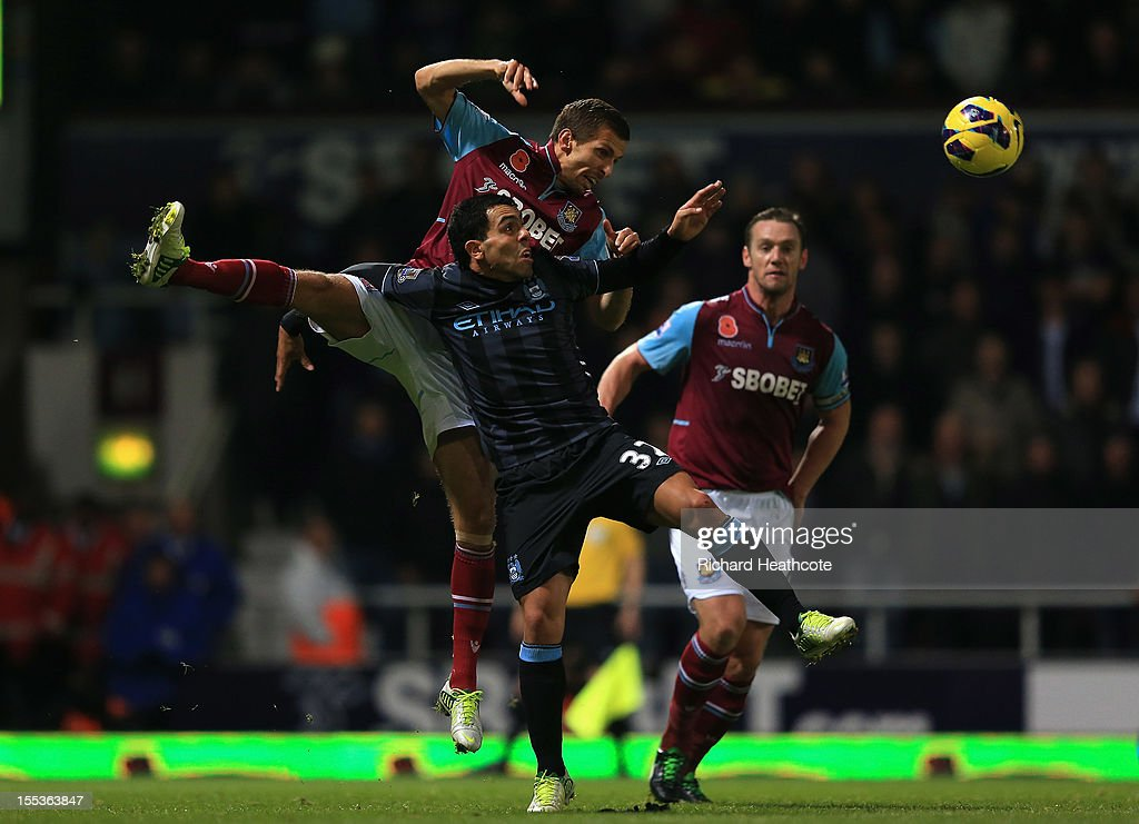 <a gi-track='captionPersonalityLinkClicked' href=/galleries/search?phrase=Gary+O%27Neil&family=editorial&specificpeople=683120 ng-click='$event.stopPropagation()'>Gary O'Neil</a> of West Ham United jumps for a header with <a gi-track='captionPersonalityLinkClicked' href=/galleries/search?phrase=Carlos+Tevez&family=editorial&specificpeople=220555 ng-click='$event.stopPropagation()'>Carlos Tevez</a> of Manchester City during the Barclays Premier League match between West Ham United and Manchester City at the Boleyn Ground on November 3, 2012 in London, England.