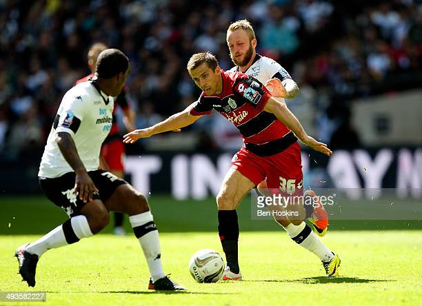 Gary O'Neill of QPR holds off pressure from Jamie Ward and Andre Wisdom of Derby during the Sky Bet Championship Playoff Final match between Derby...