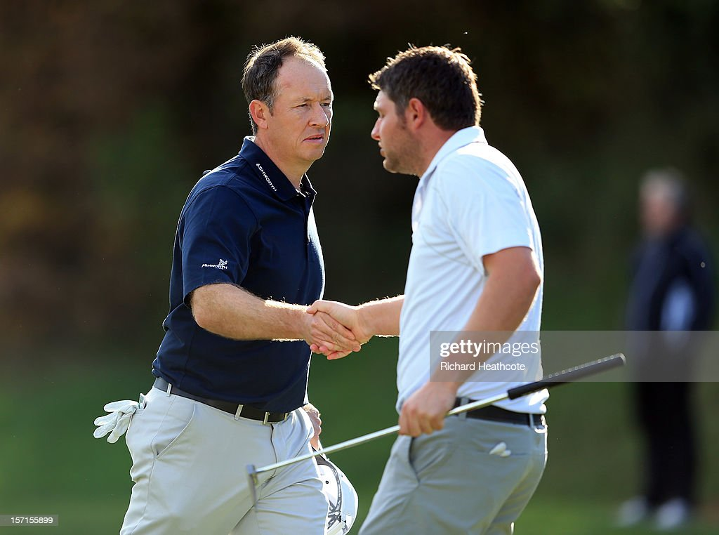 Gary Orr of Scotland shakes hands with George Murray of Scotland as they both drop shots at the 18th hole, but Orr manages to retain his card by a single shot and Murray misses out by a shot during the final round of the European Tour Qualifying School Finals at PGA Catalunya Resort on November 29, 2012 in Girona, Spain.