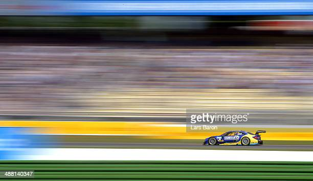 Gary Paffett of Great Britain and Mercedes HWA drives during the first round of the DTM 2014 German Touring Car Championship at Hockenheimring on May...