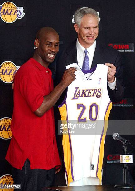 Gary Payton and Lakers general manager Mitch Kupchak at Staples Center press conference to announce contract signing with the Lakers
