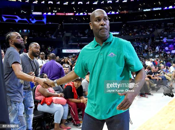 Gary Payton coach of the 3 Headed Monsters greets fans as he walks on the court for the game against Ghost Ballers for a rebound during the BIG3 game...
