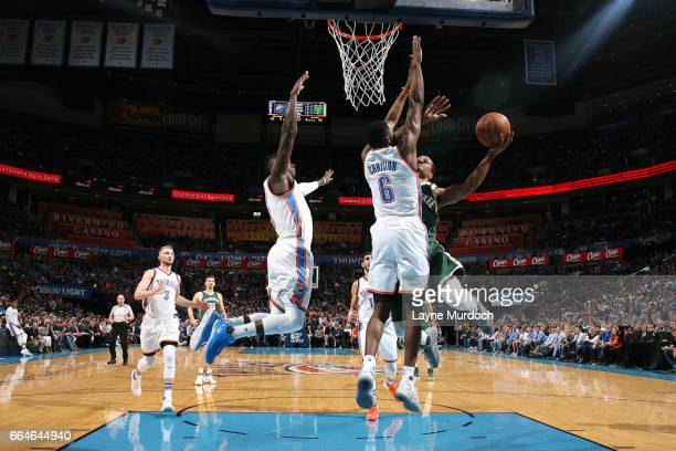 Gary Payton II of the Milwaukee Bucks goes for a lay up during the game against the Oklahoma City Thunder on April 4 2017 at Chesapeake Energy Arena...