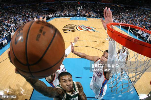 Gary Payton II of the Milwaukee Bucks shoots a lay up during the game against the Oklahoma City Thunder on April 4 2017 at Chesapeake Energy Arena in...
