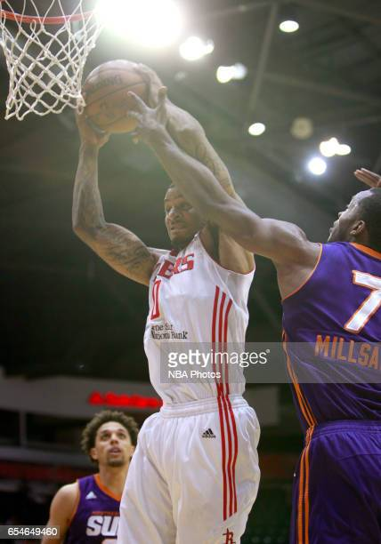 Gary Payton II of the Rio Grande Valley Vipers grabs a rebound over Elijah Millsap of the Northern Arizona Suns at the State Farm Arena March 17 2017...