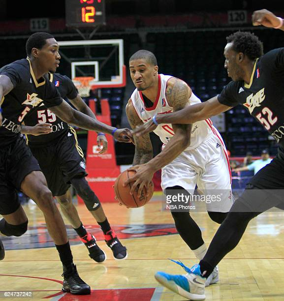 Gary Payton II of the Rio Grande Valley Vipers handles the ball between Alex Davis and TJ Price of the Erie BayHawks at the State Farm Arena November...