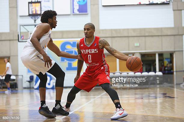 Gary Payton II of the Rio Grande Valley Vipers handles the ball against Tyrone Wallace of the Salt Lake City Stars at Bruins Arena on December 17...