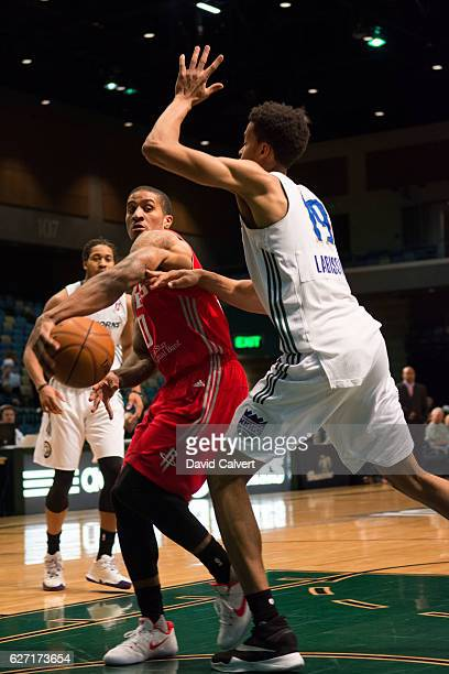 Gary Payton II of the Rio Grande Valley Vipers passes around defender Skal Labissiere of the Reno Bighorns at the Reno Events Center on December 1...