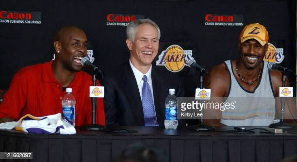 Gary Payton Lakers general manager Mitch Kupchak and Karl Malone at Staples Center press conference to announce contract signing of Payton and Malone...