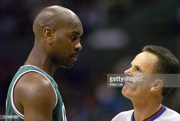 Gary Payton of the Boston Celtics argues with referee Mike Callahan during the 134127 double overtime victory over the Los Angeles Clippers at the...