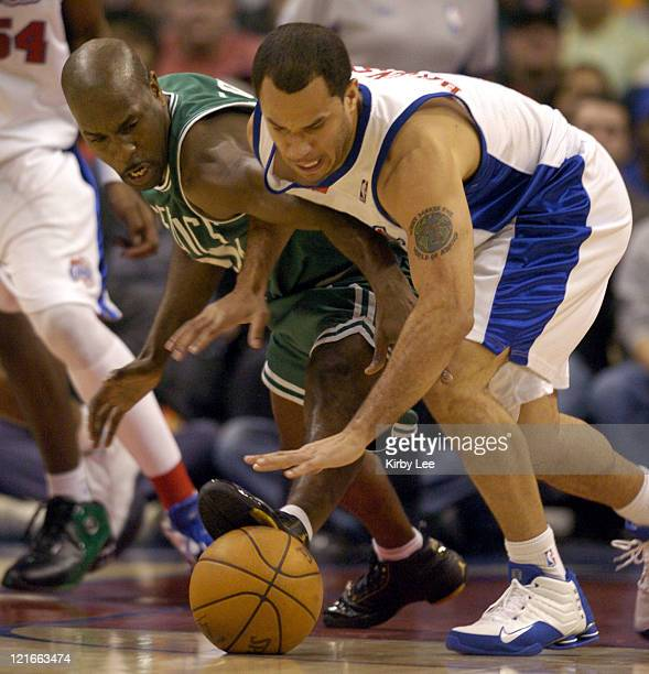 Gary Payton of the Boston Celtics battles Rick Brunson of the Los Angeles Clippers for ball during the 134127 double overtime victory over the...