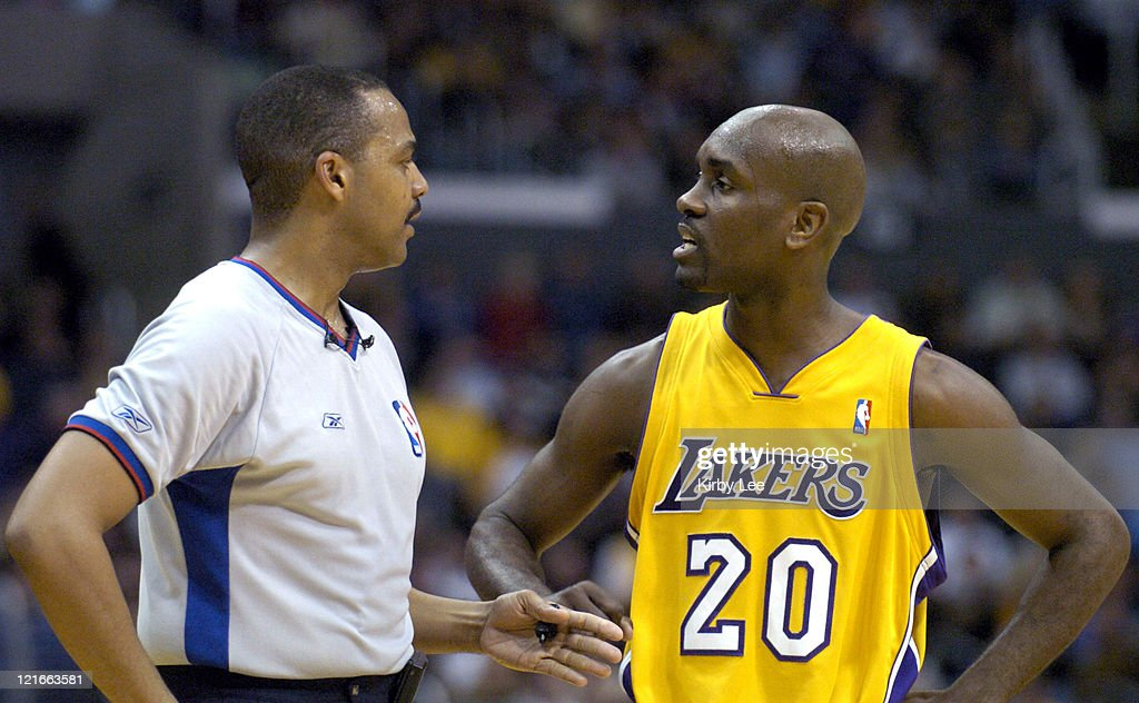Gary Payton of the Los Angeles Lakers argues a ruling by referee Bennie Adams during the game between the Cleveland Cavaliers and the Los Angeles Lakers at the Staples Center in Los Angeles, California, on Monday, January 12, 2004. The Lakers defeated the Cavaliers 89-79.