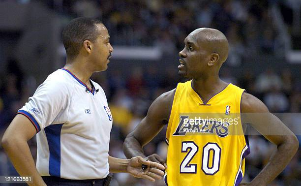 Gary Payton of the Los Angeles Lakers argues a ruling by referee Bennie Adams during the game between the Cleveland Cavaliers and the Los Angeles...