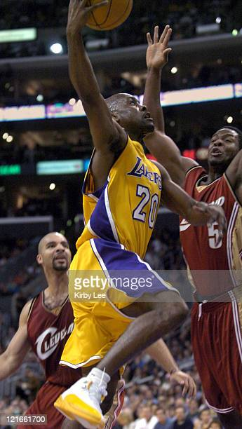 Gary Payton of the Los Angeles Lakers drives past Kedrick Brown of the Cleveland Cavaliers during the game between the Cleveland Cavaliers and the...
