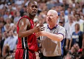 Gary Payton of the Miami Heat pleads his case to referee Joey Crawford against the Dallas Mavericks during Game One of the 2006 NBA Finals June 8...