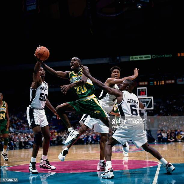 Gary Payton of the Seattle Sonics drives to the basket against the San Antonio Spurs during an NBA game on November 25 1994 at the Alamo dome in San...