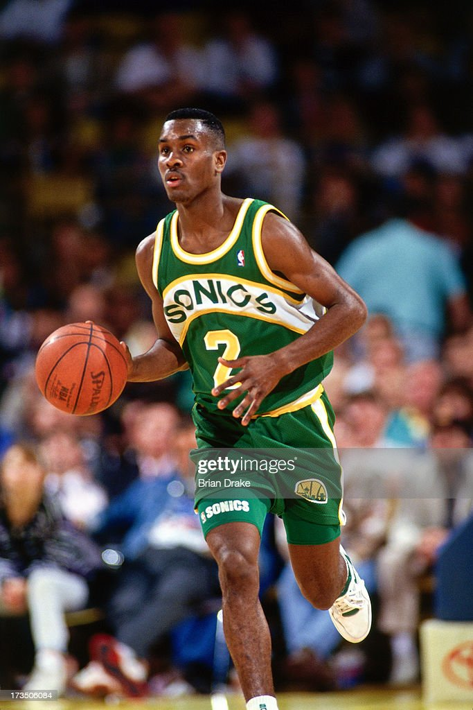 Gary Payton #2 of the Seattle SuperSonics advances the ball against the Los Angeles Lakers during a game played at the Great Western Forum in Los Angeles, California circa 1991.