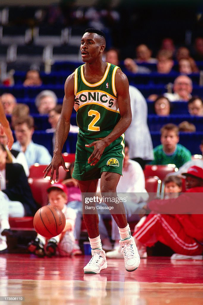 Gary Payton #2 of the Seattle SuperSonics dribbles against the Los Angeles Clippers during a game played at the Los Angeles Memorial Sports Arena in Los Angeles, California circa 1991.