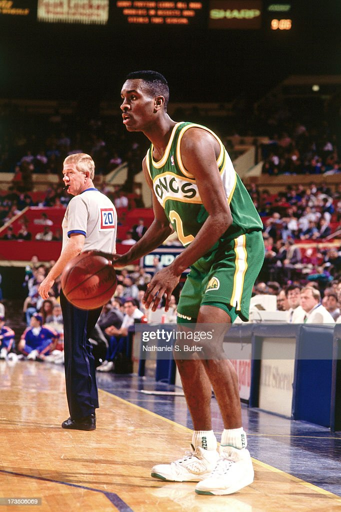 Gary Payton #2 of the Seattle SuperSonics dribbles against the New York Knicks during a game played at Madison Square Garden in New York, New York circa 1991.