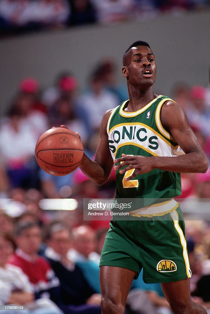 Gary Payton #2 of the Seattle SuperSonics dribbles during a game played at the Seattle Center Coliseum in Seattle, Washington circa 1991.