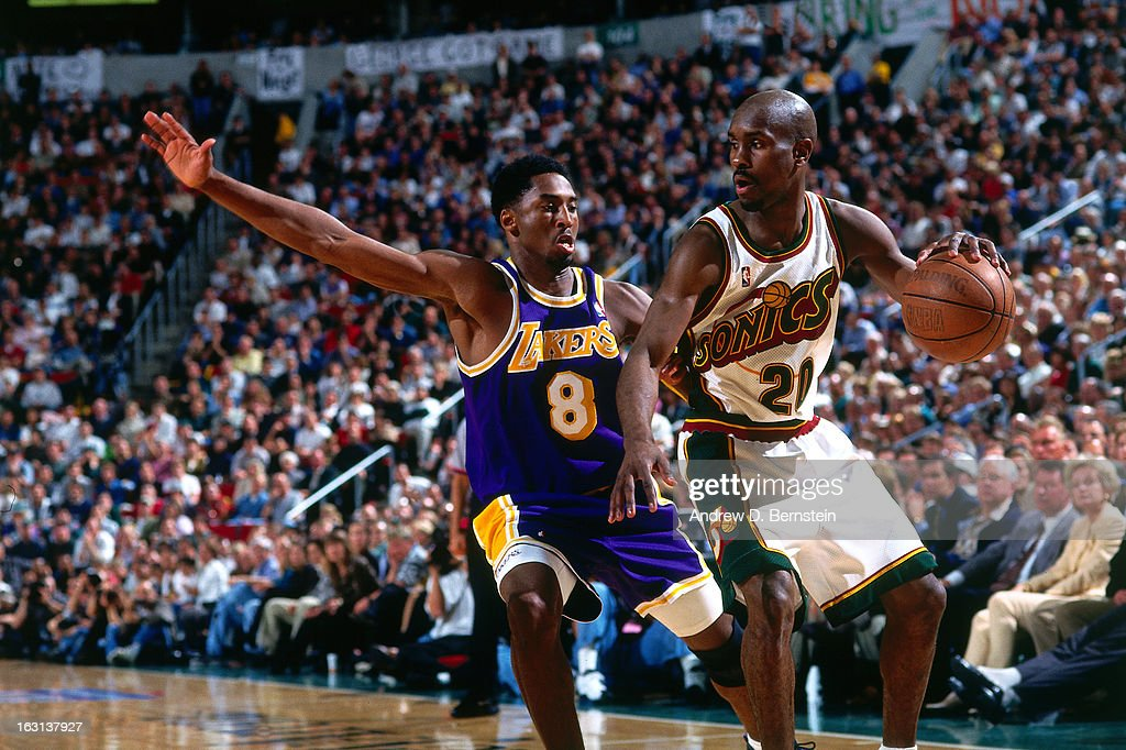 <a gi-track='captionPersonalityLinkClicked' href=/galleries/search?phrase=Gary+Payton&family=editorial&specificpeople=201500 ng-click='$event.stopPropagation()'>Gary Payton</a> #20 of the Seattle Supersonics dribbles the ball against <a gi-track='captionPersonalityLinkClicked' href=/galleries/search?phrase=Kobe+Bryant&family=editorial&specificpeople=201466 ng-click='$event.stopPropagation()'>Kobe Bryant</a> #8 of the Los Angeles Lakers in Game Five of the Western Conference Semifinals as part of the 1998 NBA Playoffs, played on May 12, at the KeyArena in Seattle, Washington. User expressly acknowledges and agrees that, by downloading and or using this photograph, User is consenting to the terms and conditions of the Getty Images License Agreement. Mandatory Copyright Notice: Copyright 1998 NBAE