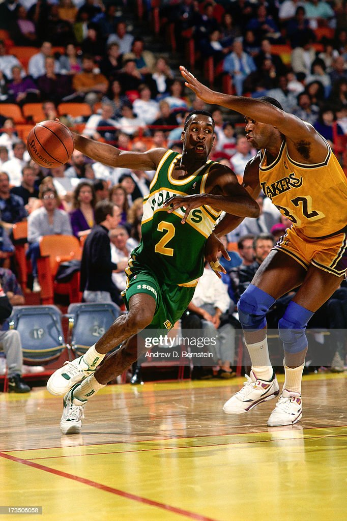 Gary Payton #2 of the Seattle SuperSonics drives against Magic Johnson #32 of the Los Angeles Lakers during a game played at the Great Western Forum in Los Angeles, California circa 1991.