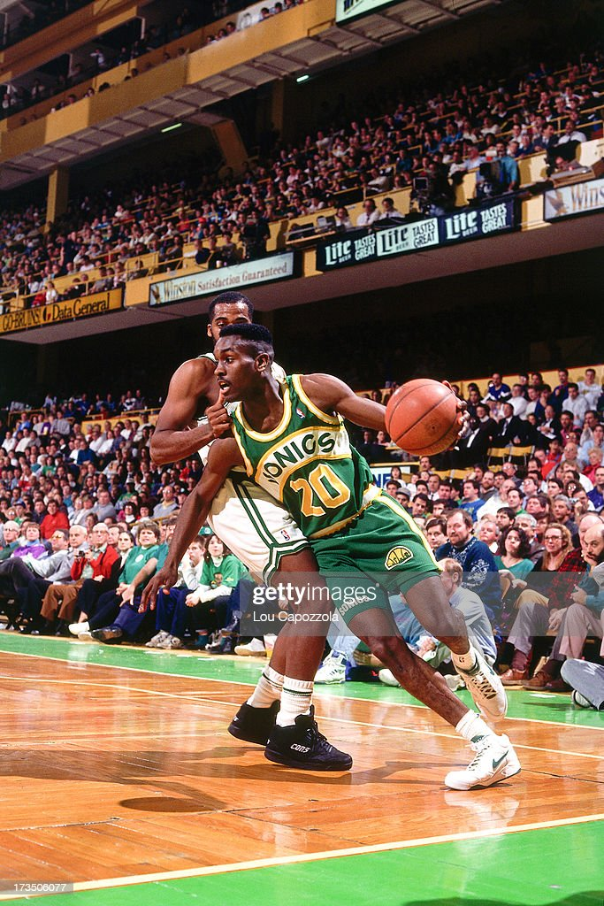 Gary Payton #20 of the Seattle SuperSonics drives against the Boston Celtics during a game played at the Boston Garden in Boston, Massachusetts circa 1991.