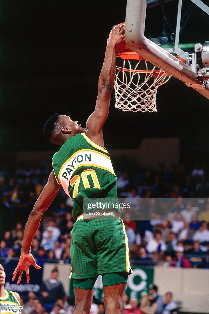 Gary Payton #20 of the Seattle SuperSonics dunks during a game played at the Seattle Center Coliseum circa 1991.