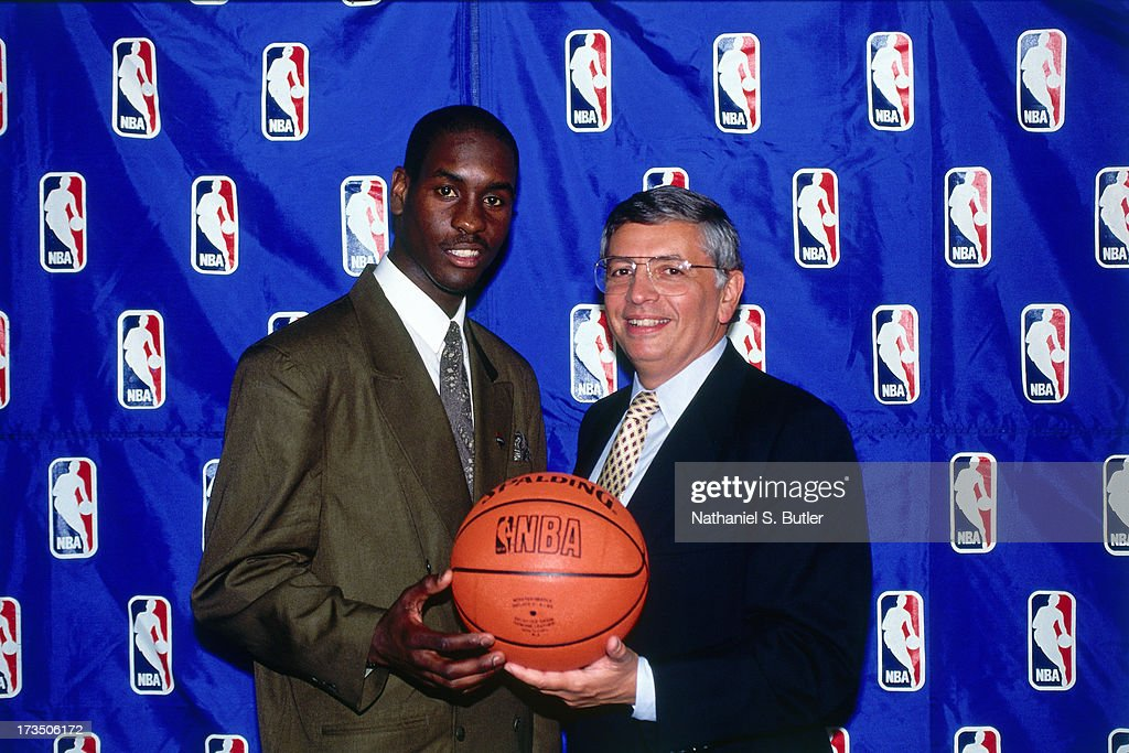 Gary Payton #2 of the Seattle SuperSonics poses with NBA Commissioner David Stern for the 1990 NBA Draft in New York, New York.