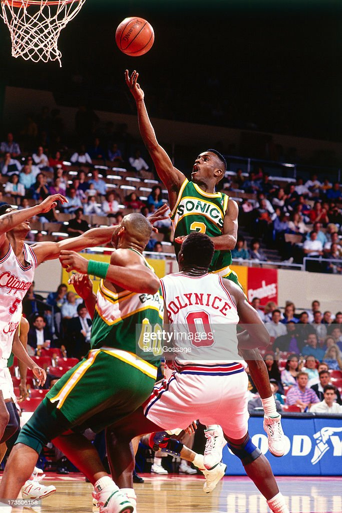 Gary Payton #2 of the Seattle SuperSonics shoots a layup against the Los Angeles Clippers during a game played at the Los Angeles Memorial Sports Arena in Los Angeles, California circa 1991.