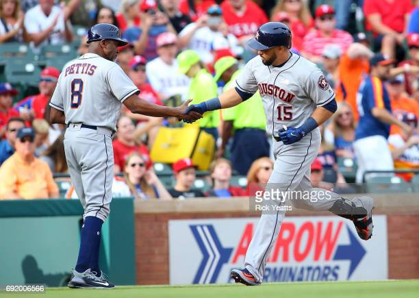 Gary Pettis of the Houston Astros congratulates Carlos Beltran for hitting a home run in the first inning against the Texas Rangers at Globe Life...