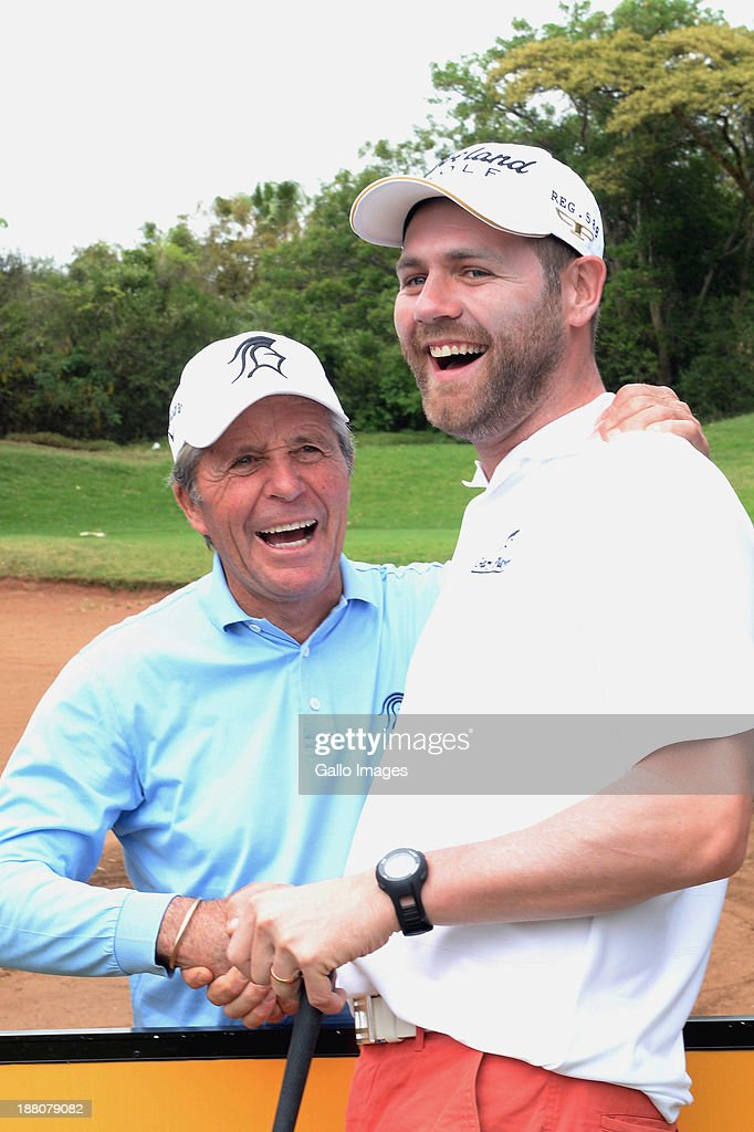 Gary Player and Brian McFadden share a joke during the Pro-Am of the Gary Player Invitational presented by Coca-Cola at The Lost City Golf Course on November 15, 2013 in Sun City, South Africa.