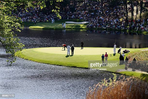 Gary Player Arnold Palmer and Jack Nicklaus in action on the eighth green during the Par 3 Contest prior to the 2009 Masters Tournament at Augusta...