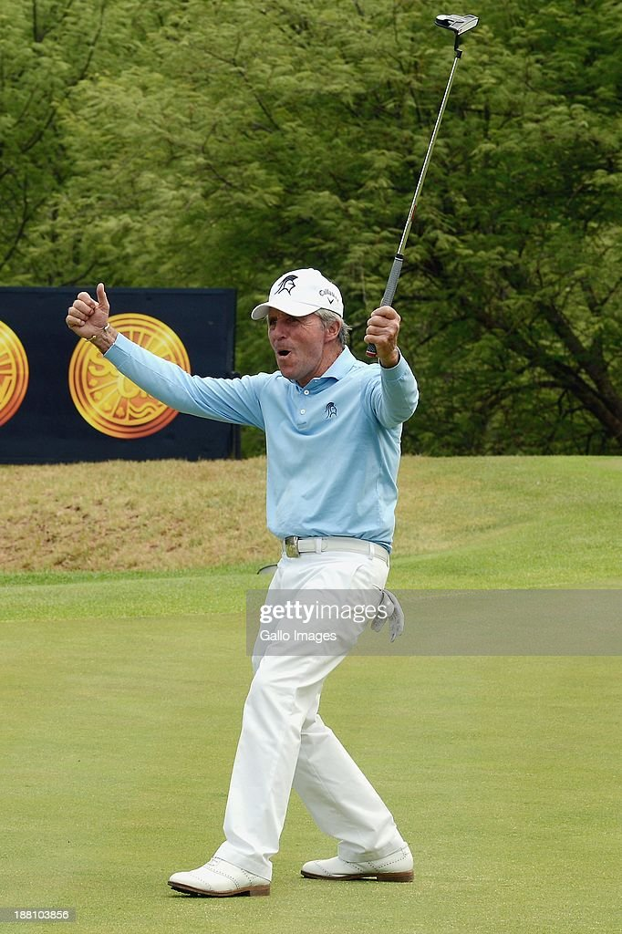 <a gi-track='captionPersonalityLinkClicked' href=/galleries/search?phrase=Gary+Player&family=editorial&specificpeople=203189 ng-click='$event.stopPropagation()'>Gary Player</a> celebrates sinking a putt during the Pro-Am of the <a gi-track='captionPersonalityLinkClicked' href=/galleries/search?phrase=Gary+Player&family=editorial&specificpeople=203189 ng-click='$event.stopPropagation()'>Gary Player</a> Invitational presented by Coca-Cola at The Lost City Golf Course on November 15, 2013 in Sun City, South Africa.